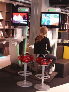 young lady playing with a new Xbox kiosk