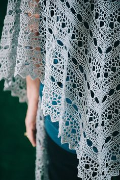 Eyelet rows and a lacy pattern of puff stitches come together in this beautifully detailed shawl. It is so light and soft you hardly notice wearing it, but even so it lends a bit of extra warmth for chillier summer nights.