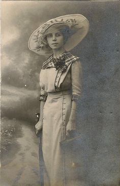 Probably c. 1910. She looks uncorseted, and fantastic.   Real Photo Postcard Woman in Picture Hat  by TableauBotanique, $15.00