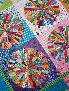 "The pattern for this quilt is from the book ""Quilts with a Spin"" by Becky Goldsmith & Linda Jenkins. The pattern in the book is called ""Everyday Best"". From www.redpepperquil....  www.redpepperquil.... I don't know if I have the skill or patience, but maybe someday...."