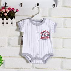 CBH099B Charlie Champ Baseball Onesie $9.50  Onesie with front snap buttons.  Who doesn't want to be on Daddy's team?  Tell your little one he's the champ everyday! 100% cotton  6-9 mths 9-12 mths 12-18 mths 18-24 mths