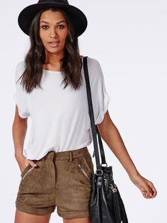 Spring / Summer - street chic style - festival style - beach style - brown suede shorts + black duffel bag + black wide brim fedora + white wide cut t-shirt