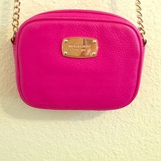 Michael kors fushia crossbody It is in good condition. There are 2 minor marks shown in the last pic. Michael Kors Bags Crossbody Bags
