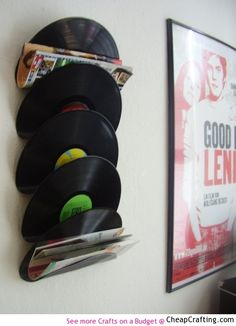 Recycled Vinyl Record Magazine Rack http://www.cheapcrafting.com/for-the-home/vinyl-record-magazine-rack/