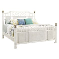 Bring island-inspired appeal to your master suite with this eye-catching bed, featuring an openwork wood and metal frame with woven accents.