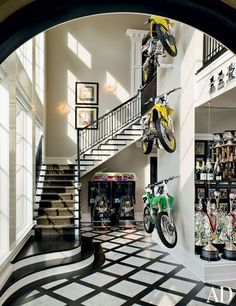Motorcycles are displayed against a double-height wall in racer Ricky Carmichael's Tallahassee, Florida, home.