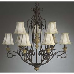 This vintage style chandelier makes an elegant addition to a room. The aged crackle and stone finish and French ivory fabric shades lend an old-fashioned look. Steel construction ensures years of dependable use. The fixture requires nine 25-watt bulbs