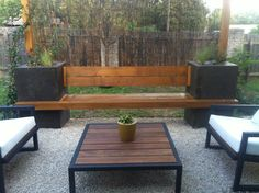 small, crushed limestone patio area with stained concrete bench with built in planters