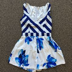 NWOT Nautical Romper NWOT Adorable Nautical Romper, never worn. Perfect for any summer occasion. Soft silky material for added comfort. Pants Jumpsuits & Rompers
