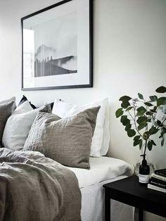 Puristic Scandinavian bedroom in sand tones
