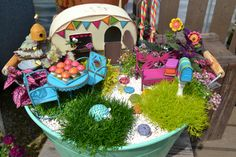 Fairy Garden Idea.  It's a Gypsy Fairy Garden complete with the camper!  Notice that all the accessories are in the same color TONE.  This makes the fairy garden easy to understand, plus its fairly uniform.