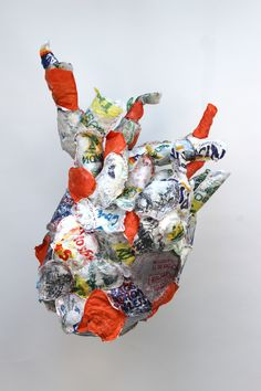 Heartless Bag is a sculptural representation of the human heart. Made entirely from recycled and unused plastic bags.  It takes up to 100 years for plastic bags to bio degrade in landfill if they are exposed to sunlight. The average life span in 2012, in the UK, was 81.5 years. This piece explores the idea that humans are likely to die long before the plastic bags they have used in their lifetime have broken down in landfill sites.