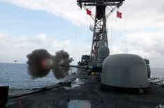 The Oliver Hazard Perry-class guided-missile frigate USS Underwood (FFG 36) fires the MK-75 76 mm/62-caliber gun during a live-fire exercise. Underwood is underway for a composite training unit exercise before deploying to Central and South America and the Caribbean for Southern Seas 2012. (U.S. Navy photo by Mass Communication Specialist 2nd Class Stuart Phillips)