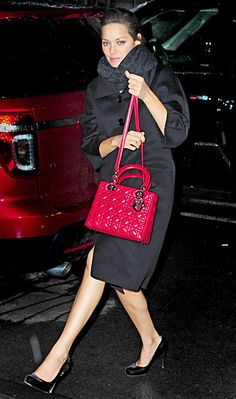 Marion Cotillard showing off her bright red #MissDior handbag in NYC