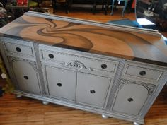 Silver buffet with stained design on top. Modern Vintage