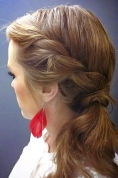 Create this French twist by adding hair section by section and twisting. Then pin and tie into a low ponytail.