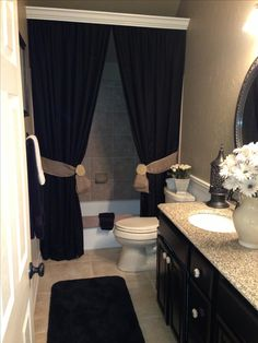 Use long drapes for shower curtain,crown molding to hide rod. I love this bathroom!