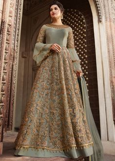 Pista green heavy embroidered anarkali suit online which is crafted from net fabric with exclusive embroidery and zari. This stunning designer anarkali suit comes with banglori bottom and net dupatta. Costumes Anarkali, Anarkali Dress, Indian Gowns Dresses, Pakistani Bridal Dresses, Bridal Anarkali Suits, Pakistani Suits, Pakistani Lehenga, Bridal Gowns, Indian Designer Outfits