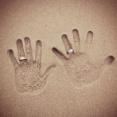 Hand prints in the sand!