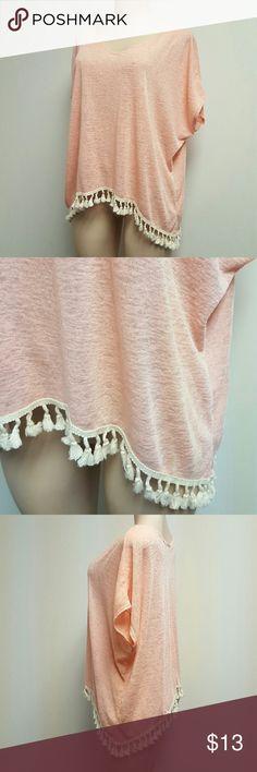 NWOT SJS flowy shawl top blouse. High low style NWOT SJS flowy shawl top blouse. Peach color with cream tassel bottom fringe. Soft and comfortable. High low style with side lower. NEW! SJS Tops Blouses