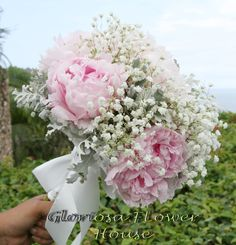 Soft pink peonies, white baby's breath, and silver dust