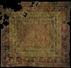 The Pazyryk Carpet - the oldest carpet ever found, probably produced by the nomadic Scythian peoples of the Altai mountains in Siberia c. 5th century BC, discovered in a Scythian burial mound in the 1940s.  The decorations include winged griffins, horses and antlered deer motifs.  Now housed in the Hermitage Museum, St Petersburg