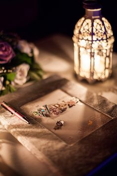 A wooden table, a little lantern, a minimal floral display and a embossed wedding wishes album is all you need. Great romantic option for a wedding on a budget.