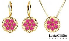 Dazzling Jewelry Set: Pendant and Earrings by Lucia Costin with Filigree Elements, Adorned with Fuchsia Swarovski Crystal Flowers; 14K Yellow Gold over .925 Sterling Silver Lucia Costin. $104.00. A perfect feminine touch. Garnished with fuchsia Swarovski crystals. Lucia Costin delicate jewelry set. Handmade in USA unique jewelry set. Style takes wings in this lovely jewelry set that have a graceful flower shape