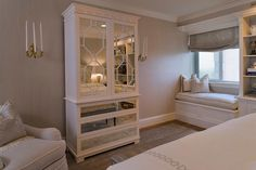 Suzie: Tiffany Eastman Interiors - Elegant bedroom with gray textured walls, white mirrored ...