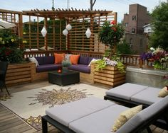 Urban rooftop oasis, love the built in coach.