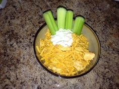 Easy buffalo chicken mac & cheese: start with a box of Kraft mac & cheese, replace some of the milk with buffalo wing sauce (to taste), add a drained can of white meat chicken. Severe with a little blue cheese dressing and celery sticks.