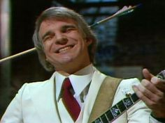 As a young, impressionable youth, Steve Martin was the first to make me laugh so hard that it brought tears of joy.  I listened to his comedy albums over and over again.  Wacky, zany, absurd, intelligent - he was the best.  On my chessboard of favorite comedians, he is the KING (probably the white one).  :)