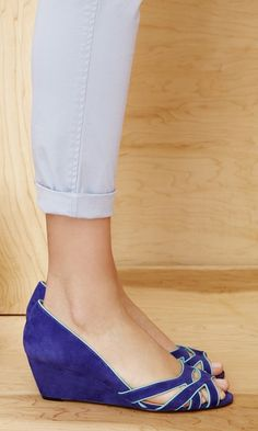 Soft suede mini wedges with a cut out front and piping detail