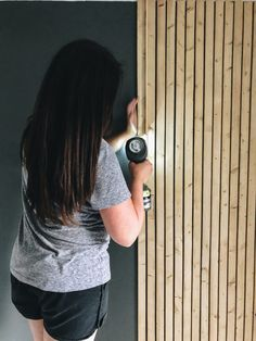 Learn how to create a wood slat wall in your home. All you need is a few power tools, lumber and a little bit of your time. Check out this DIY project! Wood Slat Wall, Wooden Slats, Wood Wall Paneling, Diy Wooden Wall, Wooden Accent Wall, Panelling, Accent Walls, Wood Cladding, Wall Cladding Interior
