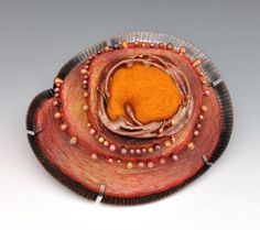 "Annie Pennington ""Diatom Series: Tucson Squiggle."" Brooch. 3 x 4 3/4 x 1 3/4 in. Copper, wool, polymer, colored pencil. 2012."