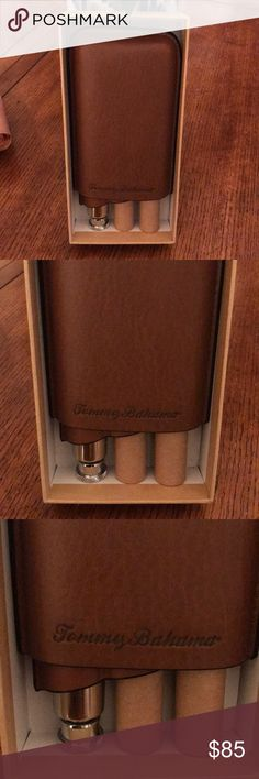 Tommy Bahama Cigar Case Brand new, in box.  Tommy Bahama cigar case.  Holds 3 cigars. Leather. Brown. Portable. Cutter on back with small holder. Tommy Bahama Accessories