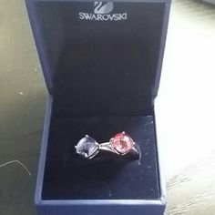 Sale!!! Swarovski Lea Tanzanite rings New with tags. Authentic Swarovski rings featuring pink and purple stones. Can wear as stackable or separate. No idea what size this is. I'm guessing approximately 6-6.5.  I can try to take more accurate measurements.  Just ask. Swarovski Jewelry Rings