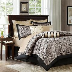 the bedding - Madison Park Wellington 12-pc. Bed Set???  This ad is set with dark tan and black striped wallpaper. White/cream curtains and area rug.  Also consider the room is flooded with light and the tan on the sheets looks very light.