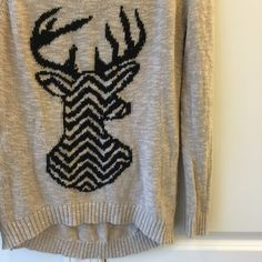 Chevron Deer Head Sweater Really cute, trendy deer head sweater. Deer head is black with chevron pattern. Scallop hem bottom covers your butt so you can pair this with leggings and boots ☺️ Sweaters Crew & Scoop Necks