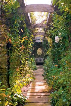 This pergola was inspired by a structure in Hestercombe in Somerset, England by architect Sir Edwin Lutyens and garden designer Gertrude Jekyll. In this version, a delightful tangle of flowering vines turns the area beneath the pergola into an intimate room.