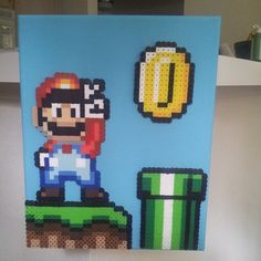 8X10 hand painted canvas, with 4 Mario themed perler sprites by tiffykinz411