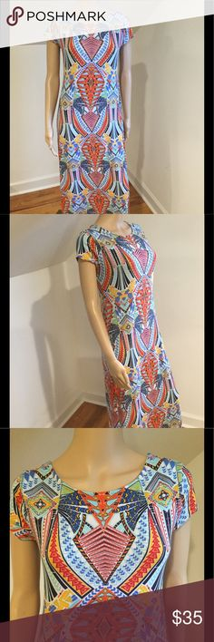 Multi Color Dress With Criss Cross Back Multi color long dress with cross cross back pre loved & like new condition. No tags approximately size medium. This is such a funky & eclectic piece! No stains & from smoke free environment. All sales final no returns or exchanges. Thanks for shopping Style Solutions! Dresses Maxi