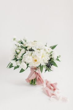 dreamy white bouquet featuring sweet peas, green eye anemones, peonies, garden roses, ranunculus, bay leaves and black privet berry by Hey Gorgeous Events