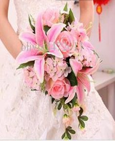 bridal bouquet. It has both the stargazer lillies and cherry blossoms in it! PERFECT! This is it!!!