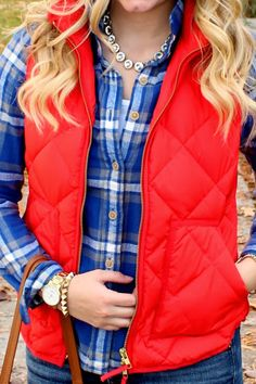 bright red vest over blue & white flannel