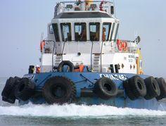 Tugboat calling to port