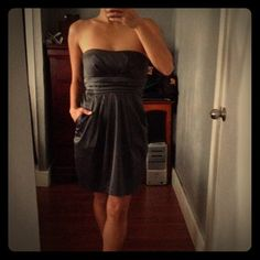 4/$20✨Charcoal strapless dress Gorgeous dress for any occasion! The back, you can tie it in a bow. Good condition!! Only worn it once for a wedding. Thank you for looking! Tag shows size 9 but fits 6-7.  Dresses Strapless