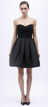 Monique Lhuillier's modernized little black bridesmaid dress boasts a sweetheart neckline and full A-line taffeta skirt that flatters all figures.