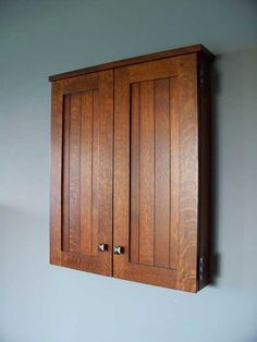 dartboard cabinet in the arts and crafts style hand crafted by craftsmen hardware company, ltd