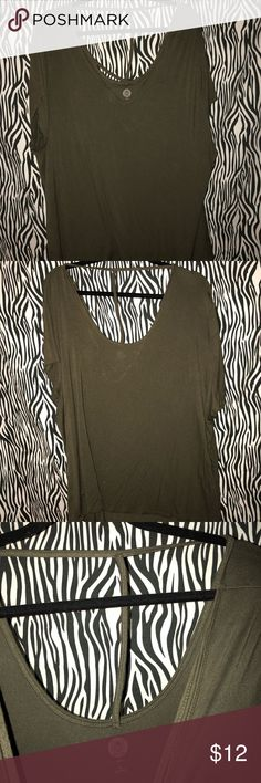 Women's 3x blouse criss cross front Super cute and comfortable olive green blouse with criss cross front and a T in the back. Cut out in back does not go down far. Never worn. Super cute with black pants and ankle boots or with jeans! Bought from Kohl's and didn't like it when i got it home. I have many other listings including the exact same shirt in burgundy and will discount for bundle. Please feel free to contact me with questions and concerns about the item or bundling! Happy shopping…